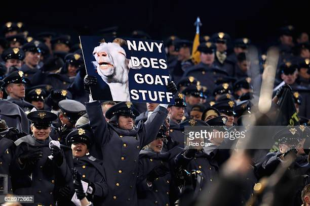 A cadet holds up a sign during the Army Black Knights and Navy Midshipmen game at MT Bank Stadium on December 10 2016 in Baltimore Maryland