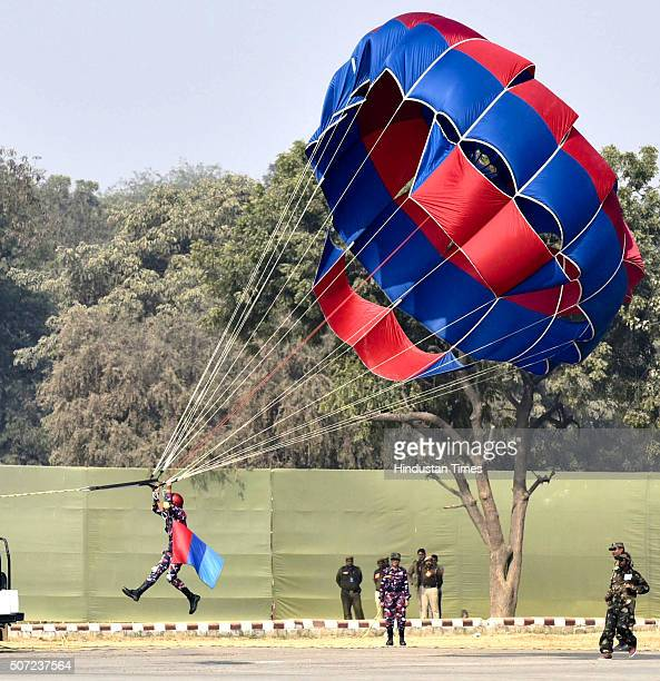 Cadet performs paragliding exercise during PM's NCC Rally at Army Parade Ground Delhi Cantt on January 28 2016 in New Delhi India Addressing the...