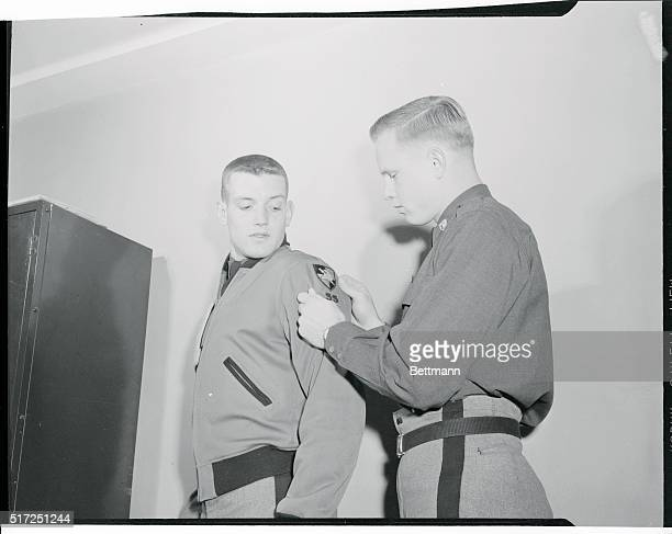 Cadet quarterback Pete Vann of Hamburg new York gets an assist from Army's captain Robert Ferris of Montgomery Alabama as it becomes necessary to put...
