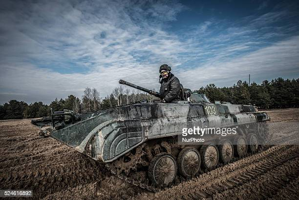 Cadet sits in his BMP1 infantry fighting vehicle which he calls 'Snizhok' during training driving armed vehicles at proving ground of the 169th...