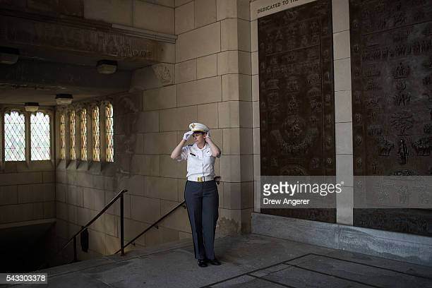 A cadet waits for the arrival of cadet candidates during the inprocessing procedures during Reception Day at the United States Military Academy at...