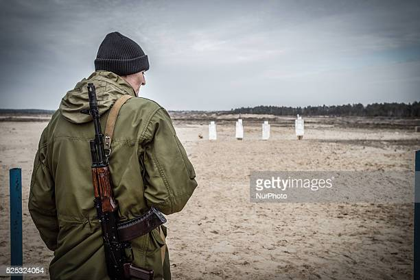 Cadet with Kalashnikov gun standing in front of targets during firing training with SPG recoilless guns and Kalashnikov guns at the 169th Training...