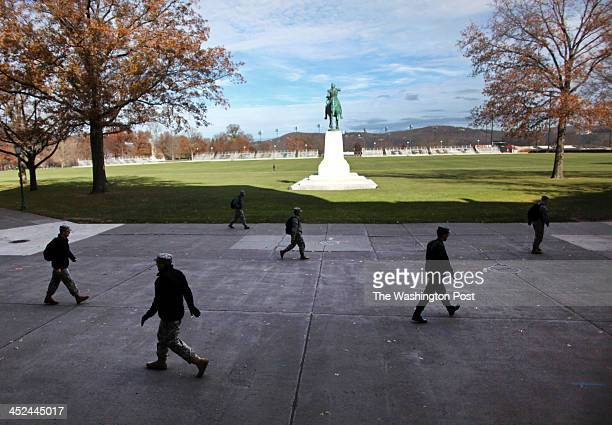 Cadets and members of the military walk through the campus of the United States Military Academy in West Point NY on November 21 2013