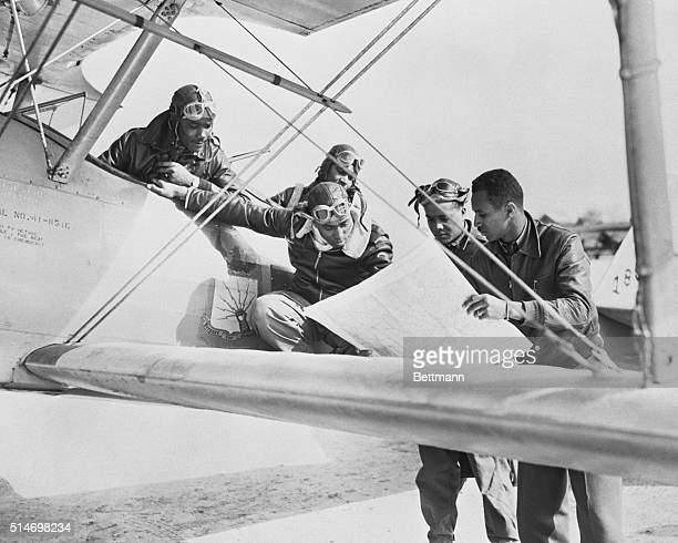 Cadets at the Negro Training Center examine a map before taking off in a biplane for a training exercise The pilots would later be known as the...