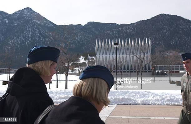 Cadets at the US Air Force Academy pass between classes February 20 2003 in Colorado Springs Colorado Air Force Chief of Staff US General John Jumper...