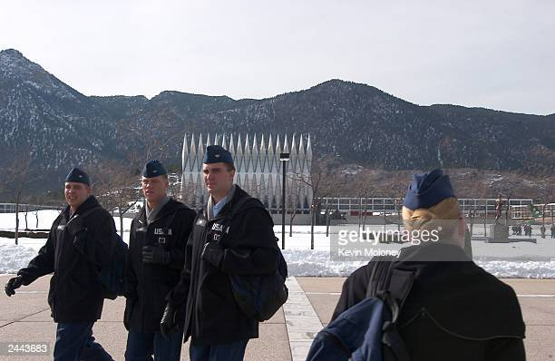 Cadets at the US Air Force Academy pass between classes February 20 2003 in Colorado Springs Colorado A Department of Defense survey of female cadets...