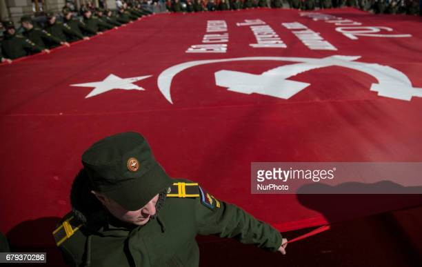 Cadets carry an enlarged copy of the Banner of Victory during a celebration of the upcoming Victory Day in StPetersburg Russia Friday May 5 2017