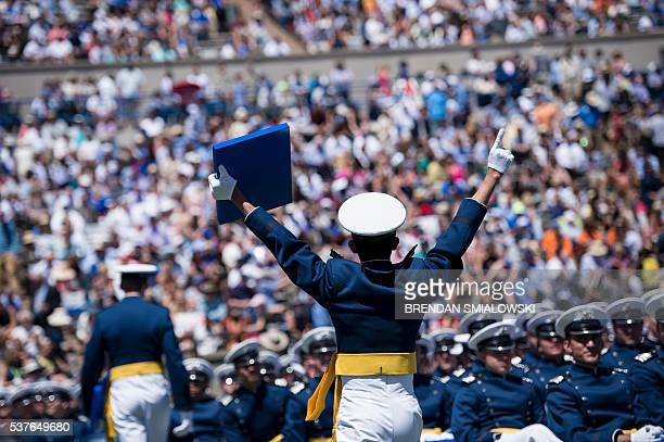 Cadets celebrate during a graduation ceremony at the US Air Force Academy's Falcon Stadium June 2 2016 in Colorado Springs Colorado US President...