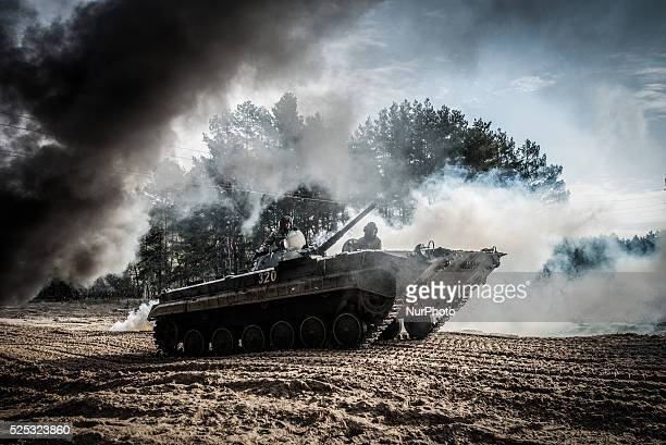 Cadets drive the BMP1 infantry fighting vehicle during fullscale rehearsal of military maneuvers at proving ground of the 169th Training center of...