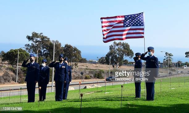 Cadets from the Jay Weinsoff Cadet Squadron salute after placing the first US Flag to commemorate the 20th anniversary of 9/11 during the annual...