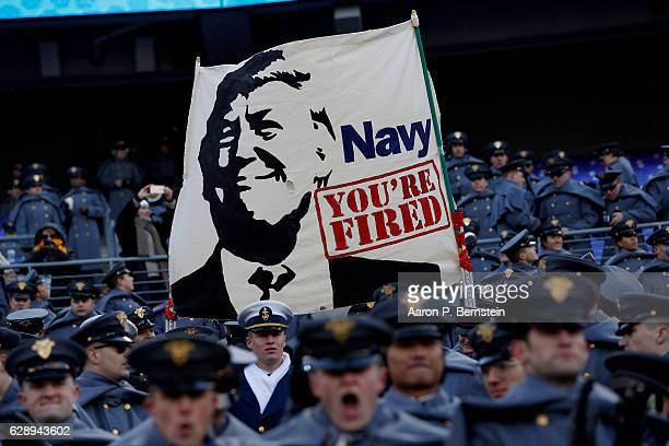 Cadets from the US Military Academy fly a banner depicting President Elect Donald Trump prior to the game between the Navy Midshipmen and the Army...
