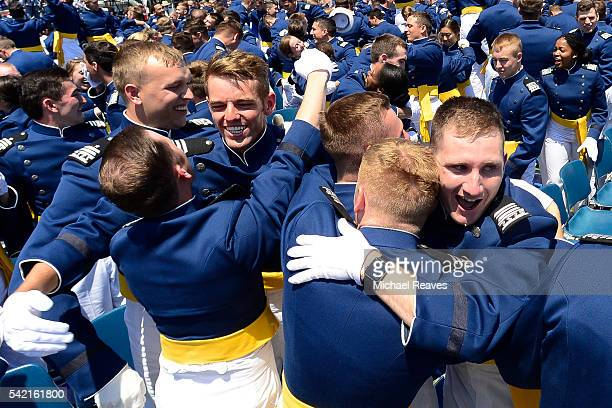 Cadets hug after receiving their diploma during the United States Air Force Academy 58th graduation commencement on June 2 2016 at Falcon Stadium