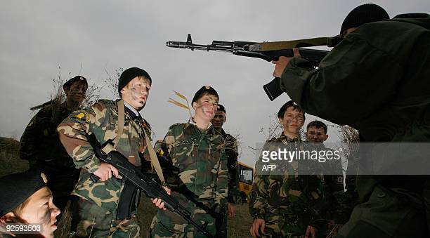 Cadets of a Stavropol Cadet School listen to an instructor during a training camp on October 31 2009 in a field not far from the village of...