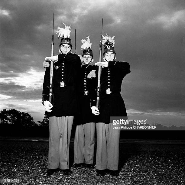 Cadets presenting arms in the courtyard of SaintCyr military school circa 1960 in France