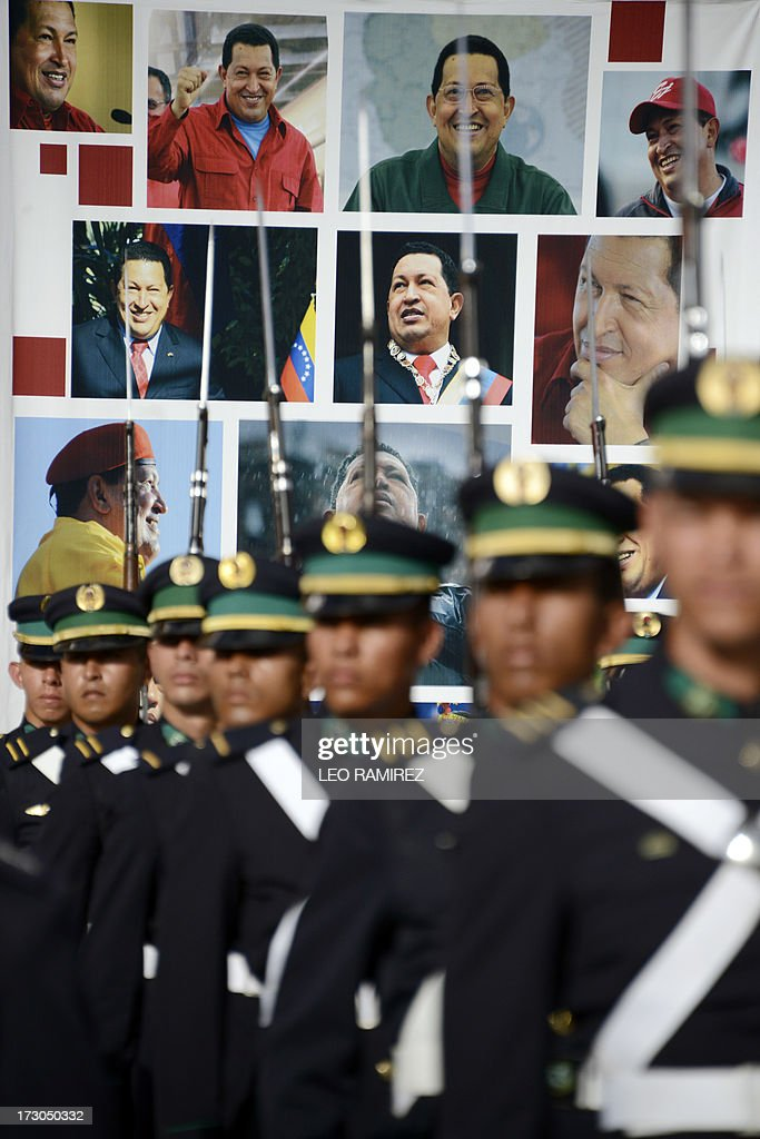 Cadets stand firm in front of posters of late Venezuelan President Hugo Chavez during the Armed Forces promotion ceremony held on the 202nd anniversary of Venezuela's Independence Day in Caracas on July 5, 2013. President Nicolas Maduro named the now admiral in chief Carmen Melendez as the new Defence Minister, the first woman to ever hold the job in Venezuela, and promoted 189 military men. AFP PHOTO/Leo RAMIREZ