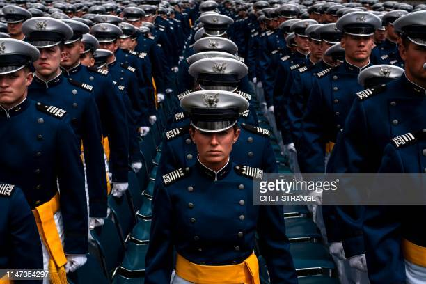 TOPSHOT Cadets stand near their seats during the 2019 graduation ceremony at the United States Air Force Academy May 30 in Colorado Springs Colorado