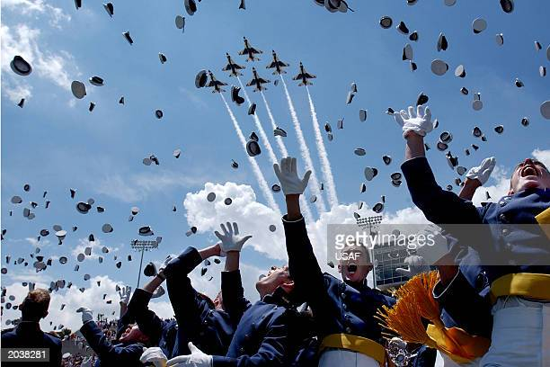 Cadets toss there hats in celebration after becoming newly commissioned first lieutenants marking the 45th graduating class at the US Air Force...