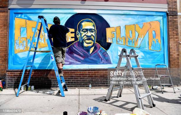 MINNEAPOLIS MINNESOTA Cadex Herrera continues work on a mural to George Floyd on the side of Cup Foods at 38th St and Chicago Ave in Minneapolis on...