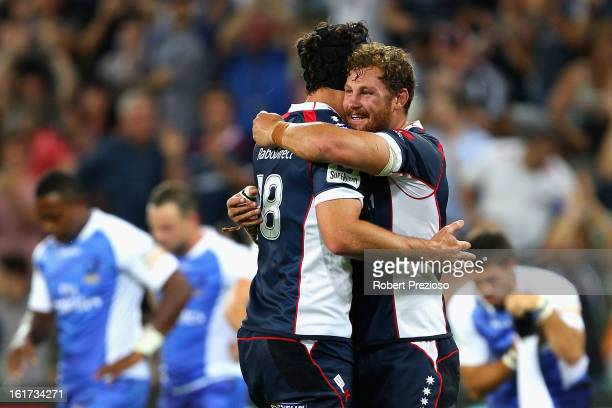 Cadeyrn Neville and Scott Higginbotham of the Rebels celebrate a win during the round one Super Rugby match between the Rebels and the Force at AAMI...