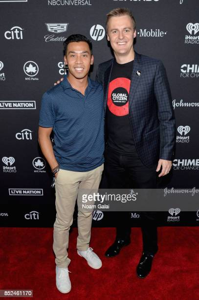 Cadillac Associate Director Brand Partnerships and Experiences Nathan Tan and Humanitarian Hugh Evans pose in the VIP Lounge during the 2017 Global...