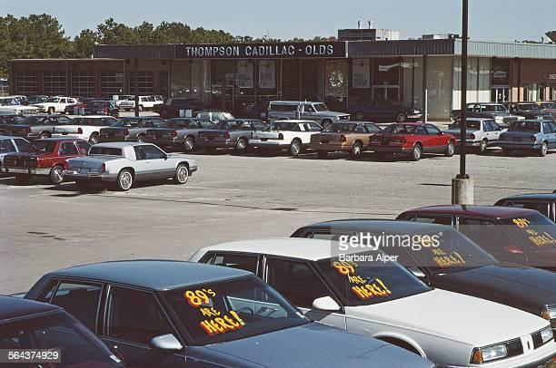 A Cadillac car dealership forecourt in Raleigh North Carolina USA October 1988