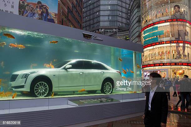 Cadillac car exhibited under water with goldfish on the street as advertising on March 18 2016 in Guangzhou China China will increase 25 million cars...