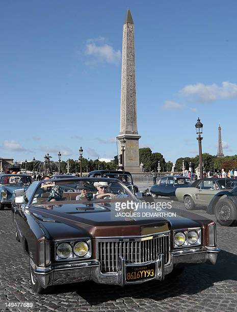 A Cadillac passes by the Concorde square in Paris on July 29 during a vintage cars parade as part of the fifth summer edition of the 'Traversee de...