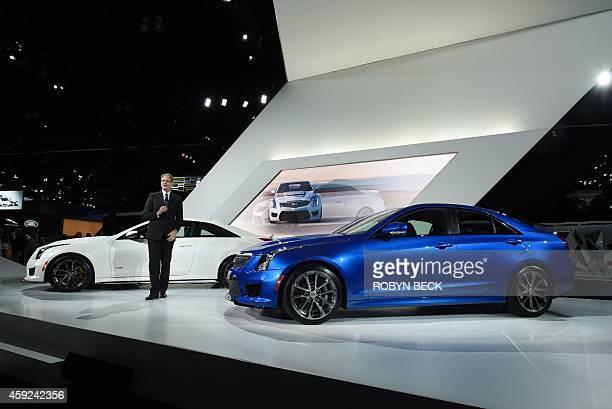 Cadillac President Johan de Nysschen unveils the Cadillac 2016 ATSV coupeand sedan at the LA Auto Show media day November 19 2014 in Los Angeles...
