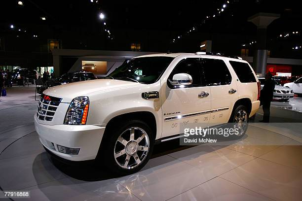Cadillac shows its big hybrid Escalade SUV during a two-day media preview of the Los Angeles Auto Show, first major North American car show of the...