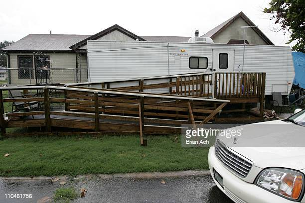 A Cadillac sits outside a FEMA trailer in St Bernard's parish in New Orleans With nearly every house uninhabitable in the area about 1/3 of the...