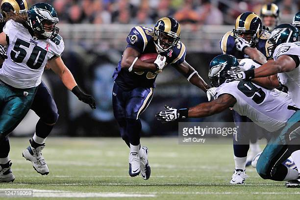 Cadillac Williams of the St Louis Rams runs and pushes off of Cullen Jenkins of the Philadelphia Eagles at the Edward Jones Dome on September 11 2011...