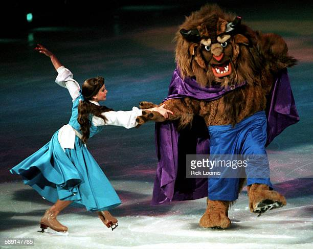 CAdisneybeast1226RL–Anaheim––Nicole Batesson–Rock as Beauty and Jarrod Koepke as the Beast skate together during Saturday's Disney on Ice production...
