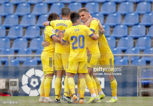 Cadiz CF players celebrate their first goal, an own goal scored by David Timor of Getafe CF during the La Liga Santander match between Getafe CF and...