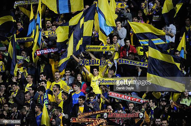 Cadiz fans cheer on their team before the start of the Copa del Rey Round of 32 First Leg match between Cadiz and Real Madrid at Ramon de Carranza...