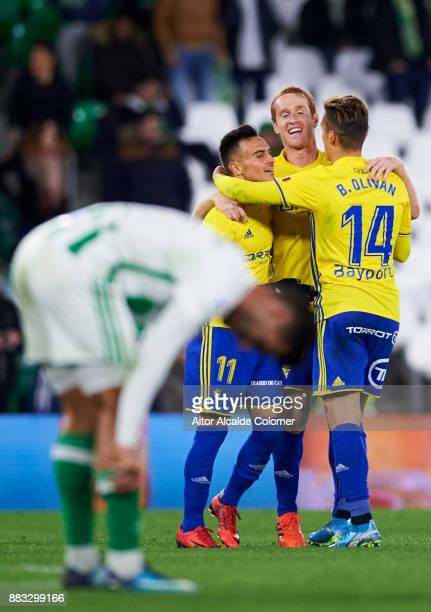 Cadiz players celebrate after eliminating Real Betis at the end of the Copa del Rey Round of 32 Second Leg match between Real Betis Balompie and...