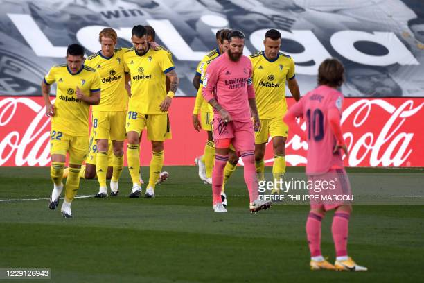 Cadiz players celebrate Cadiz's Honduran forward Anthony Lozano's goal during the Spanish League football match between Real Madrid CF and Cadiz CF...