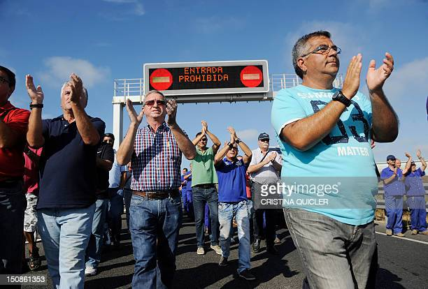 Cadiz shipyard workers applaud Manuel Sanchez Gordillo mayor of Marinaleda and member of the regional Andalusian parliament representing the United...