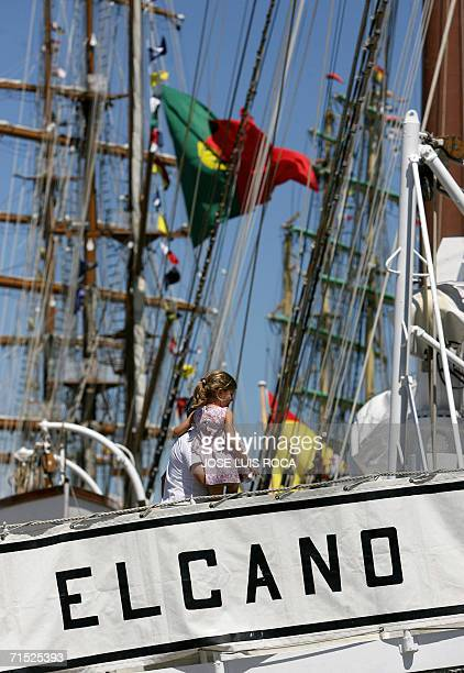 A father and daughter visit the Spanish tall ship Juan Sebastian Elcano docked 27 July 2006 in the port of Cadiz southern Spain during the 50th...