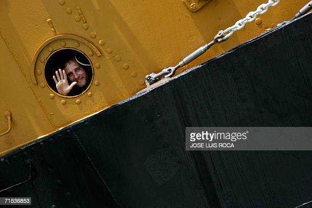 A sailor of tall ship Amerigo Vespucci greets after leaves the port of CAdiz southern Spain 29 July 2006 during the 50th edition of the Tall Ships...