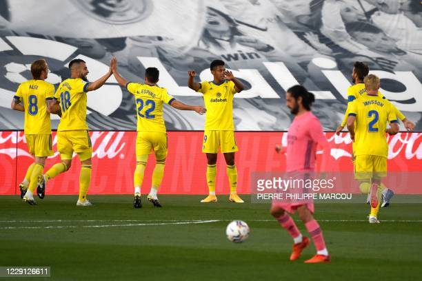 Cadiz's Honduran forward Anthony Lozano celebrates after scoring the opening goal during the Spanish League football match between Real Madrid CF and...