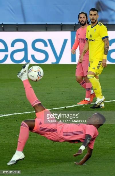 Cadiz's Spanish forward Alvaro Negredo and Isco look at Real Madrid's Brazilian forward Vinicius Junior hitting a scissor kick during the Spanish...