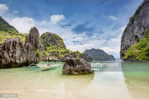 cadlao island beach bangka boat el nido palawan philippines - mlenny stock pictures, royalty-free photos & images
