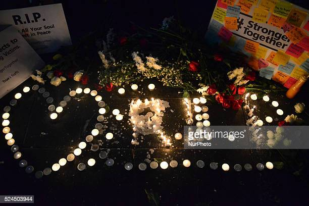 Cadles lit by well-wishers reading 'RIP', flowers and placards are seen near the Erawan Shrine in Bangkok, Thailand on August 18, 2015. In the...