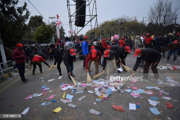 Cadres and Supporters of faction of ruling Nepal Communist Party cleaning road after the program against the dissolution of House of Representatives...