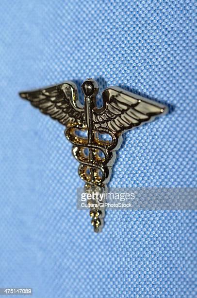 Caduceus pin attached to a shirt