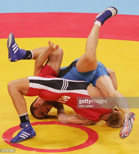 Cael Sanderson of the United States and Siarhei Borchanka of Belarus compete during the men's Freestyle wrestling 84 kg elimination round on August...
