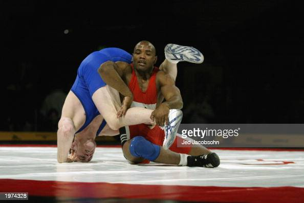 Cael Sanderson of the USA competes against Yoel Romero of