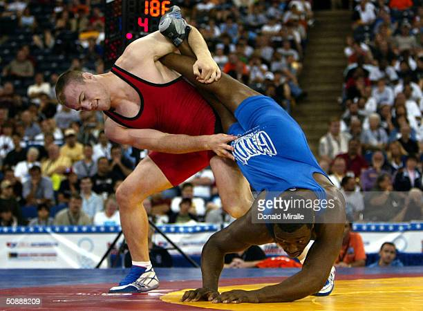 Cael Sanderson throws Muhammed Lawal in the Men's Semifinals Freestyle 84 KG during the 2004 Olympic Team Trials of Wrestling on May 22, 2004 at the...