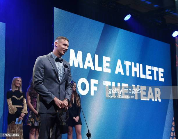 Caeleb Dressel accepts the Golden Goggle Award for Male Athlete of the Year during the 2017 USA Swimming Golden Goggle Awards at JW Marriott at LA...