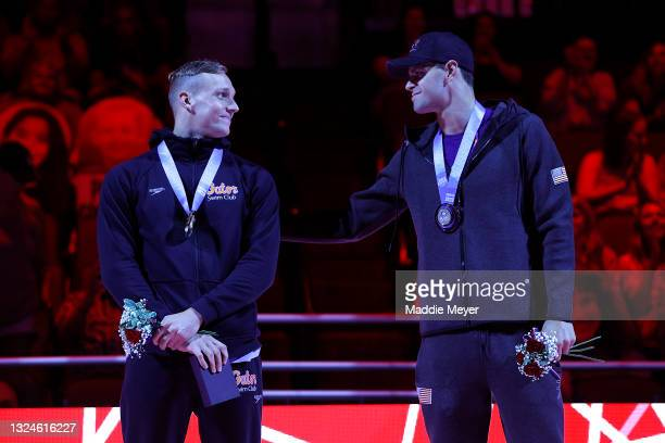Caeleb Dressel and Michael Andrew react during the Men's 50m freestyle medal ceremony during Day Eight of the 2021 U.S. Olympic Team Swimming Trials...